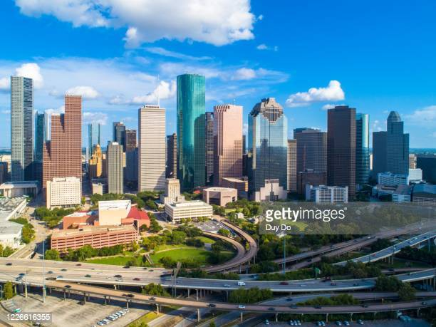 high quality picture of building downtown houston, texas at buffalo bayou park taking by drone - houston stock pictures, royalty-free photos & images