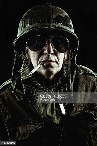 high rank officer enjoying one cigaret after a difficult mission