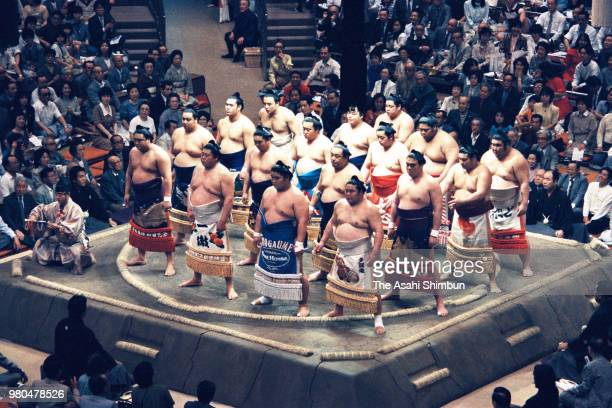 High ranked sumo wrestlers line up for Emperor Hirohito on day seven of the Grand Sumo Summer Tournament at Ryogoku Kokugikan on May 16 1987 in Tokyo...