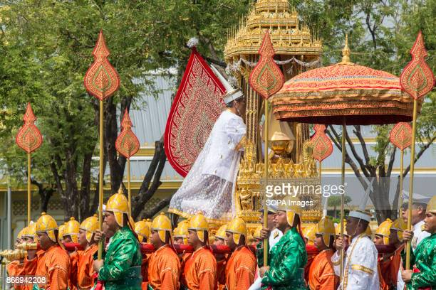 A high ranking buddhist monk holds the royal funeral urn of the departed King Bhumibol Adulyadej during the ceremony for moving the royal relics and...