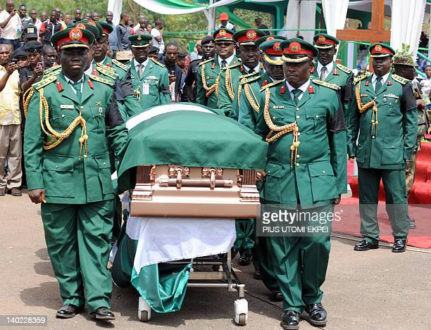 High ranking military officers and pall bearers carry the coffin of Nigeria's secessionist leader Odumegwu Ojukwu during the national...
