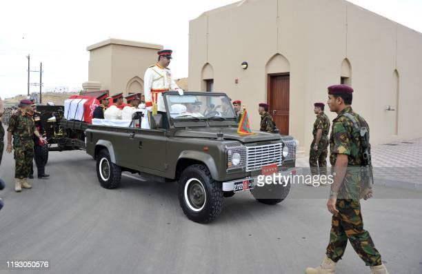 High ranking Omani army officials transport the coffin of the late Omani leader Sultan Qaboos toward the royal family cemetary in the capital Muscat...