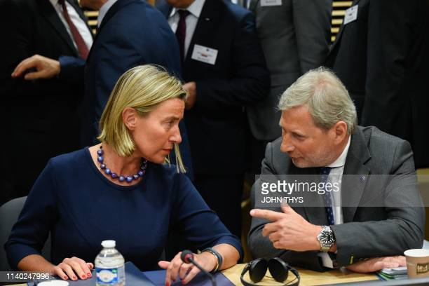 High Representative Federica Mogherini talks with EU Commissioner for Enlargement Negotiations Johannes Hahn before their annual spring meeting of...