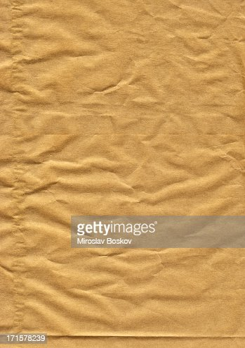 high resolution crumpled brown paper background stock