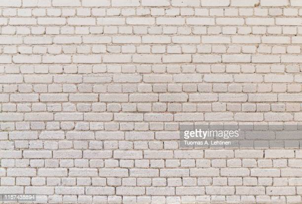 high resolution full frame background of detailed old pale brick wall. - 漂白した ストックフォトと画像