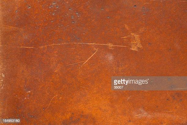 a high resolution rusty metal surface with scratch marks - rusty stock pictures, royalty-free photos & images