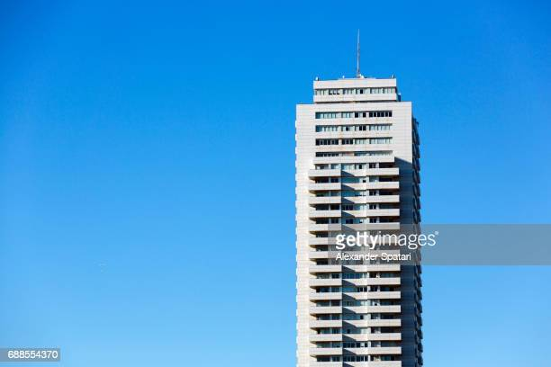 high rise building against clear blue sky - wolkenkratzer stock-fotos und bilder