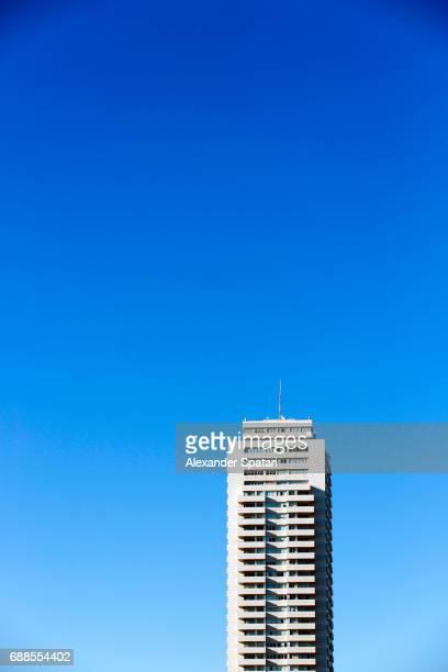 High rise building against clear blue sky