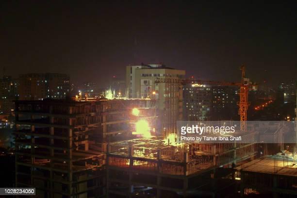 high rise building construction at night; dhaka, bangladesh - dhaka stock pictures, royalty-free photos & images