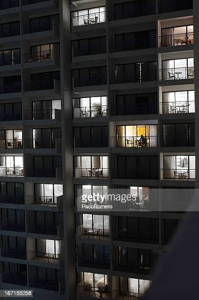 High rise building with person working at night