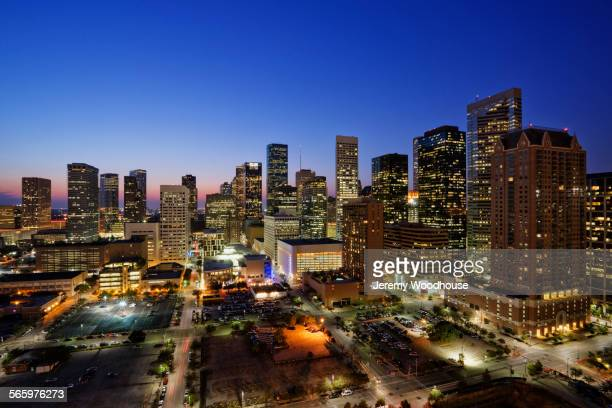 high rise buildings in houston cityscape illuminated at sunset, texas, united states - houston texas fotografías e imágenes de stock