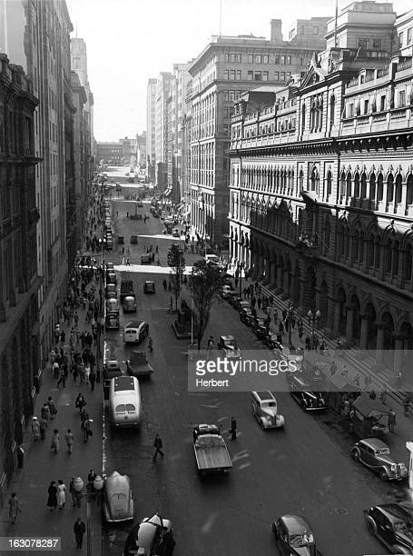 High rises buildings shadowing the industrious Martin Place the heart of the city's business center Sydney Australia 1955