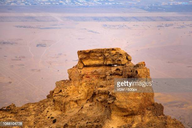 High rock towering over desert