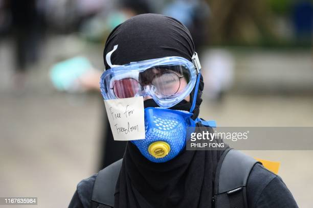 TOPSHOT A high school alumnus has his right eye covered as a sign of solidarity with a protester with an eye injury that demonstrators blamed on a...