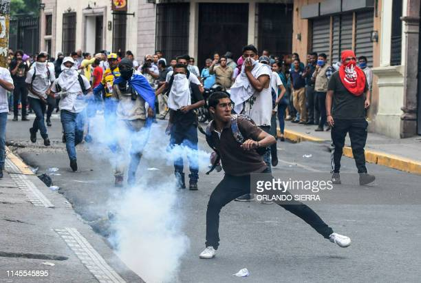 High school and National Institute of Professional Training students clash with riot police during a protest against Honduran President Juan Orlando...