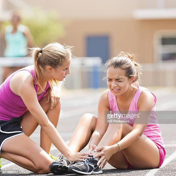 high school athlete crying after being injured during track meet - cute highschool girls stock photos and pictures