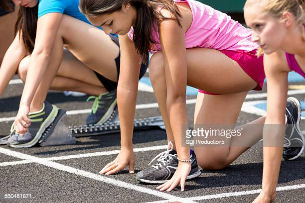 high school athletes at starting line for track meet race - competition stock pictures, royalty-free photos & images