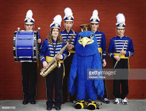 high school band members and mascot - mascot stock pictures, royalty-free photos & images