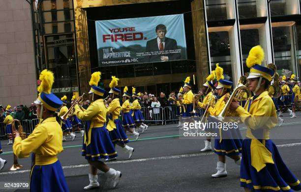 A high school band passes a banner for the television show The Apprentice during the St Patrick's Day parade March 17 2005 in New York New York's...