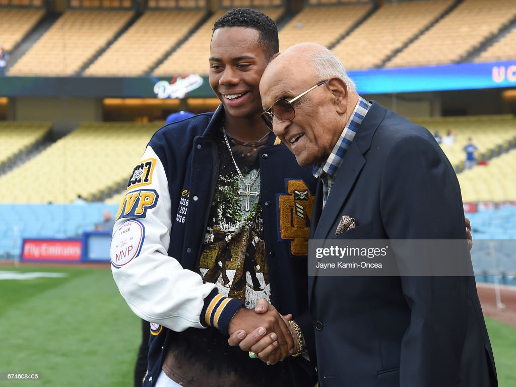 High School baseball player Hunter Greene, from Stevenson Ranch, CA, the possible first overall pick in the 2017 MLB draft, meets Hall of Famer Don Newcombe during batting practice before the game against the Philadelphia Phillies at Dodger Stadium on April 28, 2017 in Los Angeles, California.