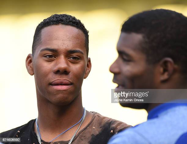 High School baseball player Hunter Greene from Stevenson Ranch CA the possible first overall pick in the 2017 MLB draft talks with Yasiel Puig of the...