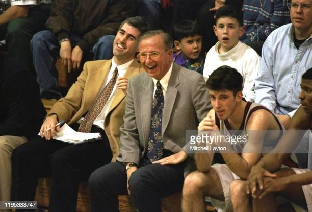 DeMatha coach Morgan Wootten sitting on bench with players during game Hyattsville MD CREDIT Mitchell Layton