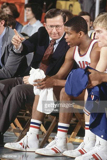 DeMatha HS coach Morgan Wootten talking to player on bench during game Hyattsville MD CREDIT Tony Triolo