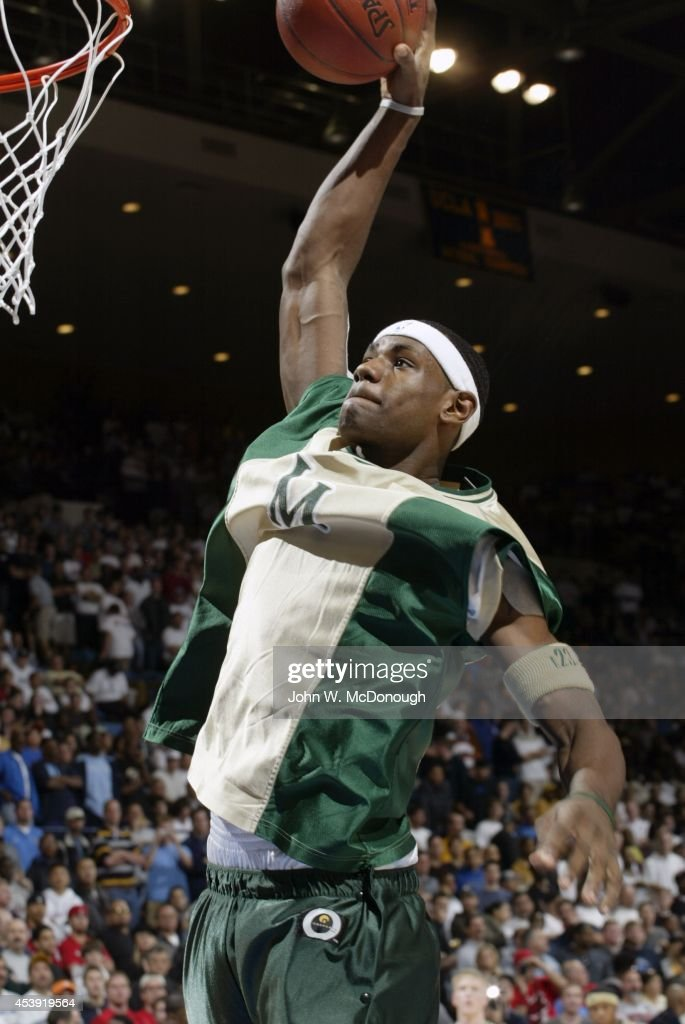 St. Vincent-St. Mary HS LeBron James (23) in action, dunk during warmups before game vs Mater Dei at Pauley Pavilion. John W. McDonough TK1 )