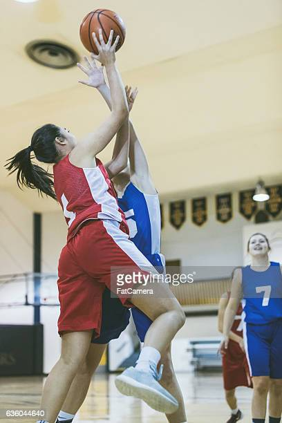 High school basketball player driving to the hoop