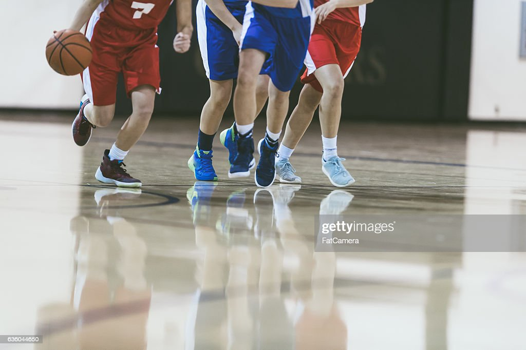High school basketball player driving to the hoop : Stock Photo