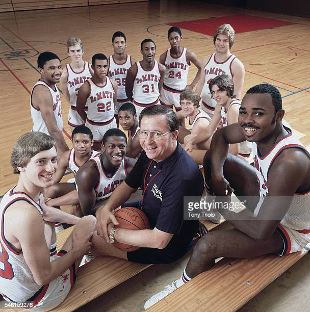 Portrait of DeMatha HS coach Morgan Wootten posing with his team during photo shoot in gym Hyattsville MD CREDIT Tony Triolo