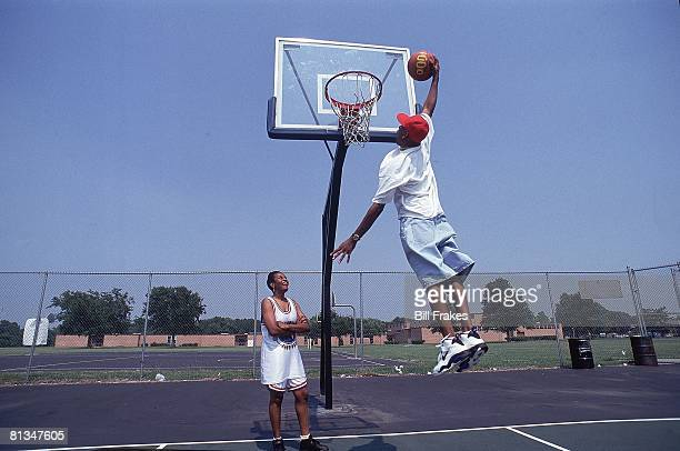 High School Basketball Portrait of Nike HS All Star Allen Iverson in action with mother Ann watching Hampton VA 7/14/1993