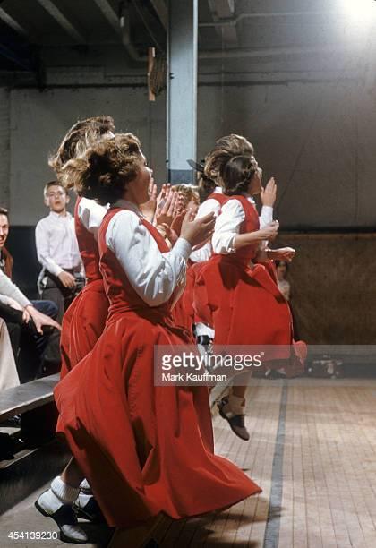 View of Alexander Graham Junior High cheerleaders in swirling red skirts during game vs Piedmont Charlotte NC CREDIT Mark Kauffman