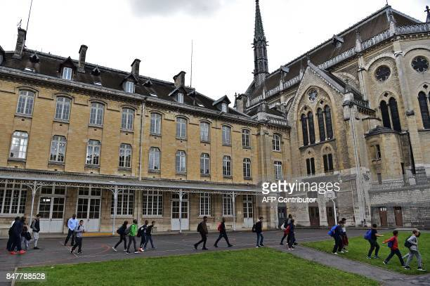 High school boarders walk towards their quarters at the end of a school day at the Apprentis d'Auteuilmanaged SaintPhilippe school in Meudon outside...
