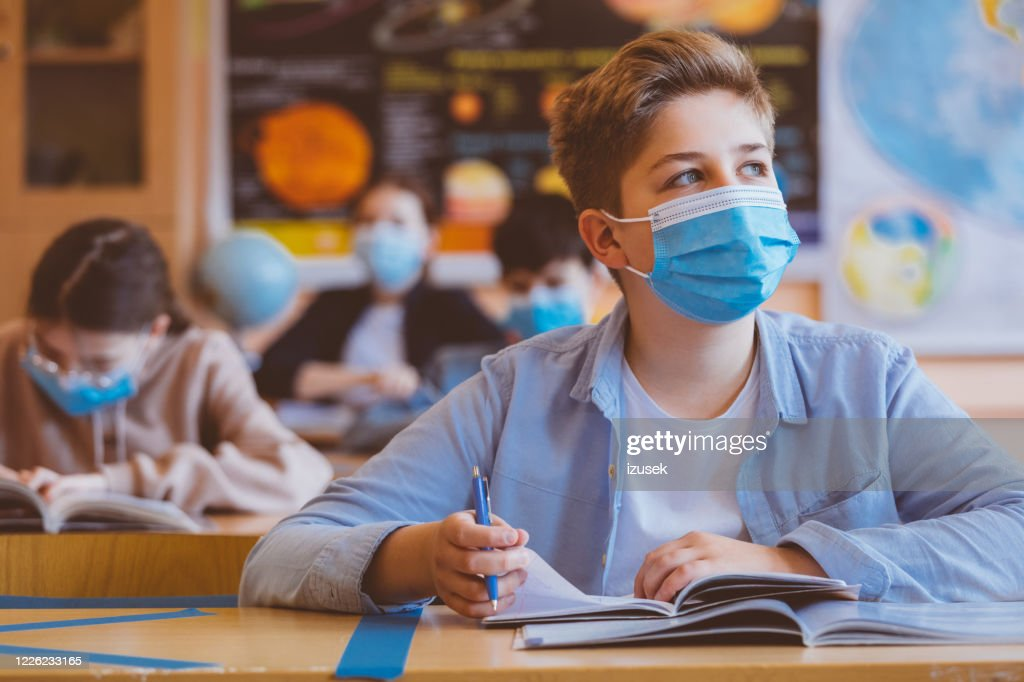 High school boy student at school wearing N95 Face masks : Stock Photo