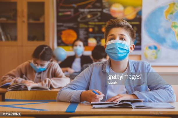 high school boy student at school wearing n95 face masks - education stock pictures, royalty-free photos & images