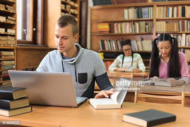 High school boy studying at library