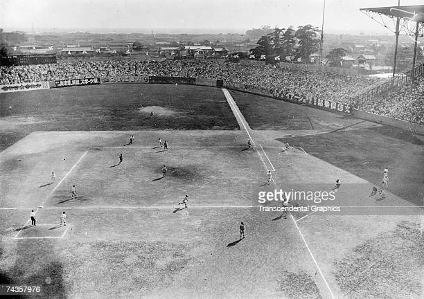 High school championship game, the World Series in Japan at this time, is underway in Koshien Stadium in Japan sometime in the 1920s.