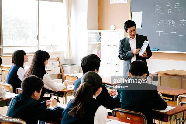 High school class and teacher with tablet computer, Japan