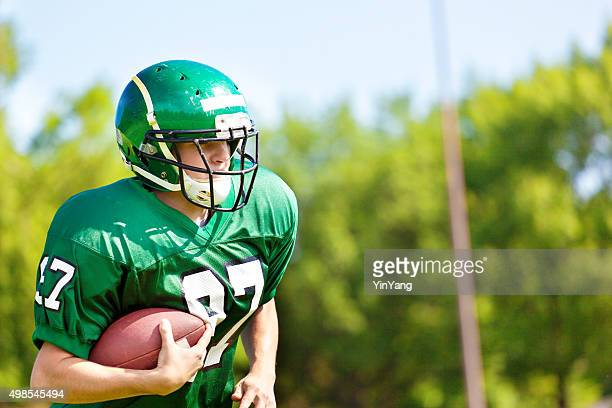 High School College American Football Player Running with Football