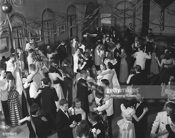 High school dance or prom with streamers hanging from ceiling overhead view