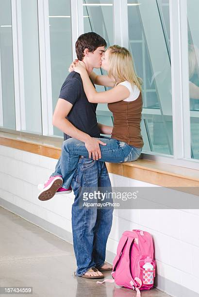 high school dating and romance, kissing in a hallway - female high school student stock pictures, royalty-free photos & images