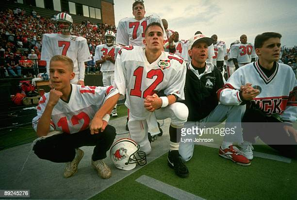 McKinley High QB Josh McDaniels with coach his father Thom McDaniels on sidelines during overtime point after tochdown attempt by Massillon HS at...