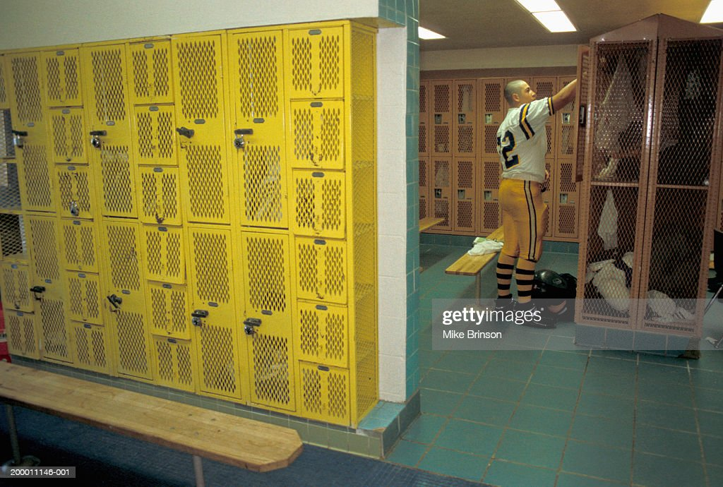 High School Football Player Standing In Locker Room Stock Photo ...