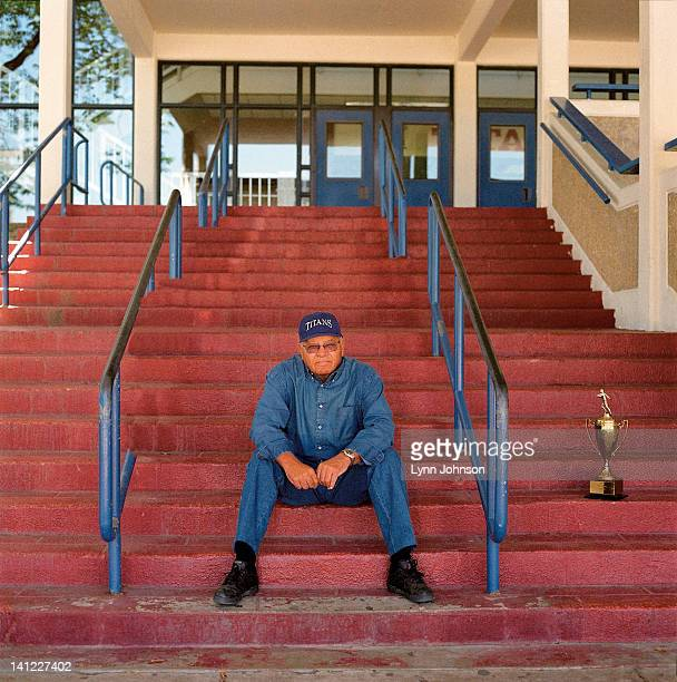 Portrait of former TC Williams High football coach Herman Boone with trophy during photo shoot The 1971 TC Williams High football team was the...