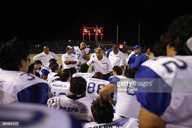 Prepa Tec Borregos Salvajes head coach Roberto Rodriguez with team in huddle after losing game vs Allen HS Eagles Allen TX 9/5/2008 CREDIT Darren...