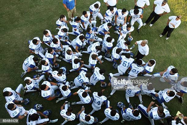 Prepa Tec Borregos Salvajes head coach Roberto Rodriguez with team in huddle before game vs Allen HS Eagles Allen TX 9/5/2008 CREDIT Darren Carroll
