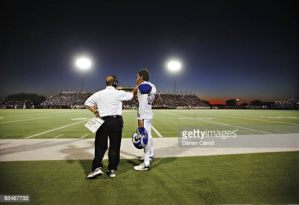 Prepa Tec Borregos Salvajes QB Jorge Alberto Sanchez with assistant coach on sidelines during game vs Allen HS Eagles Allen TX 9/5/2008 CREDIT Darren...