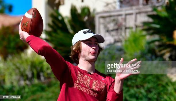 High school football quarterback Gunnar Hensley throws to his dad Brad on neighborhood streets near their home in Carlsbad, California on February...