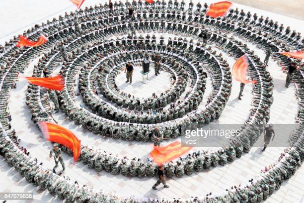 High school freshmen sit in a circle during their military training on September 15 2017 in Qiandongnan Miao and Dong Prefecture Guizhou Province of...